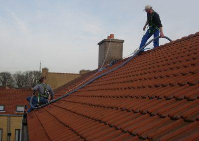 Reinigen van dakgoten en afleiders